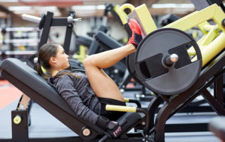 Woman on leg press machine