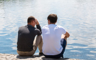 Two men talking on the dock