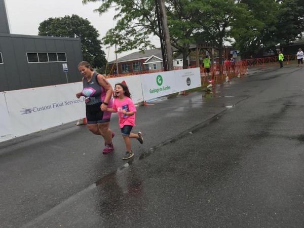 Kelly and her daughter at the Tri finish line