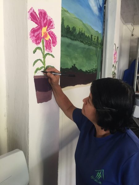 """Orchid lady painting an orchid"