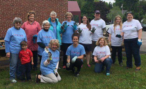 volunteers at multigenerational garden in Saco, Maine