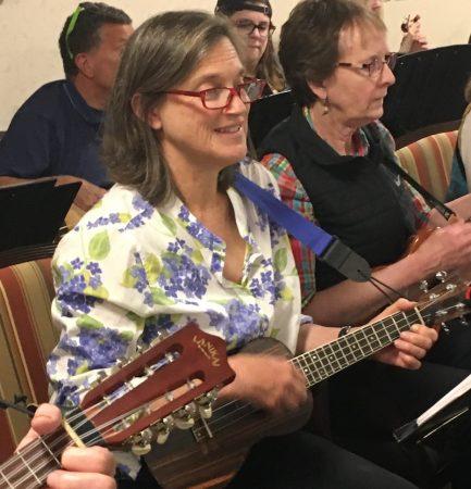 Dale Hart playing the ukulele with the FLUKES