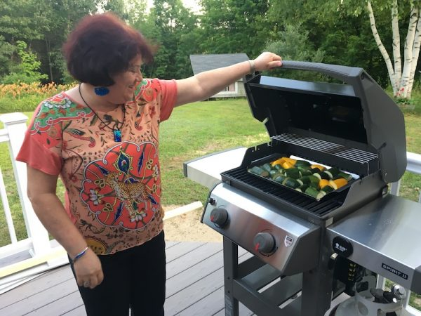 My sister-in-law grilling zucchini