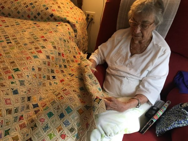 Mary Hamblen showing quilt/Conversations About Aging