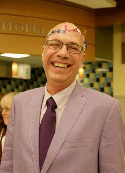 Tom Antonik wearing colorful garland on his head