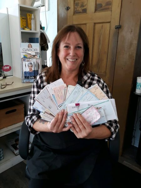 Debby with checks from 100+ Women Who Care - Southern Maine Chapter