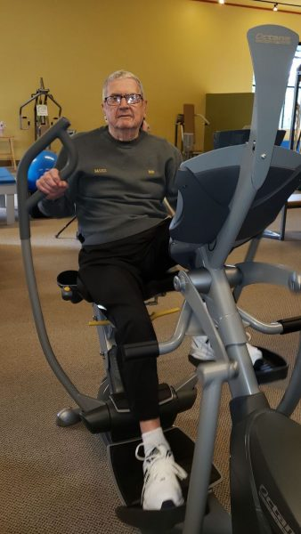 Bob Newcomb working out at Basics Fitness Center