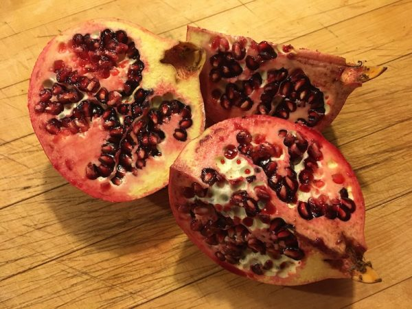 Pomegranate sections with seeds