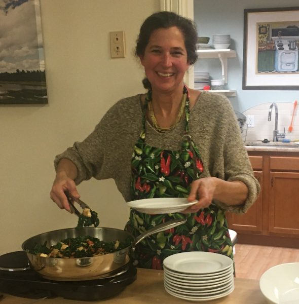 Judy Donnelly serving Cashew Kale with Tofu