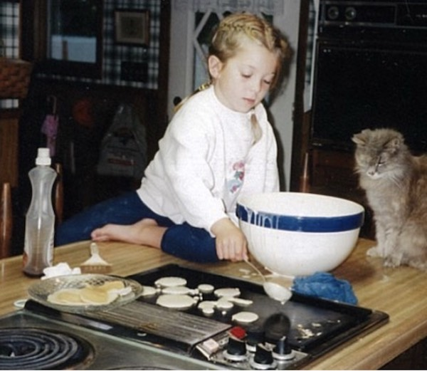 Avery Richter making pancakes as a child