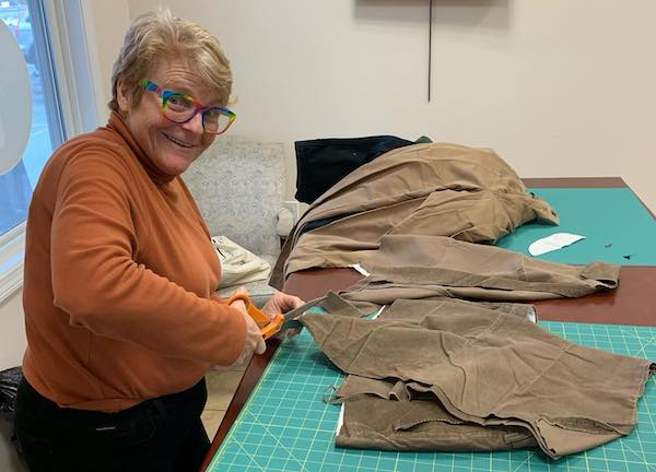Suzie Milkowich cutting up clothing