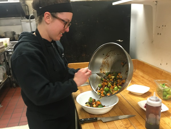 Avery Richter dishing out Butternut Squash salad
