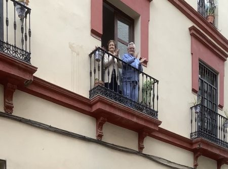 Spanish balcony with people clapping