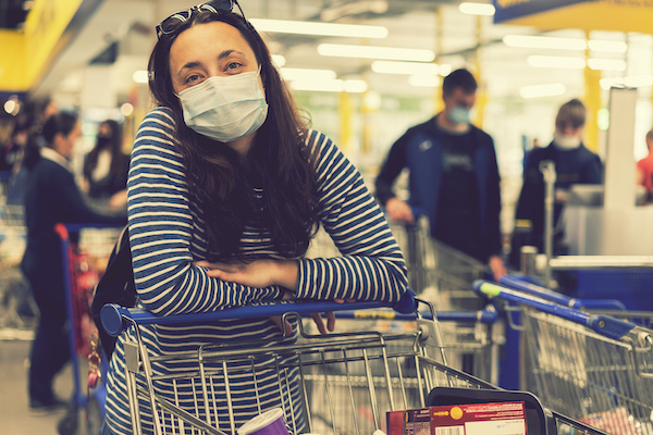 Woman in supermarket with mask