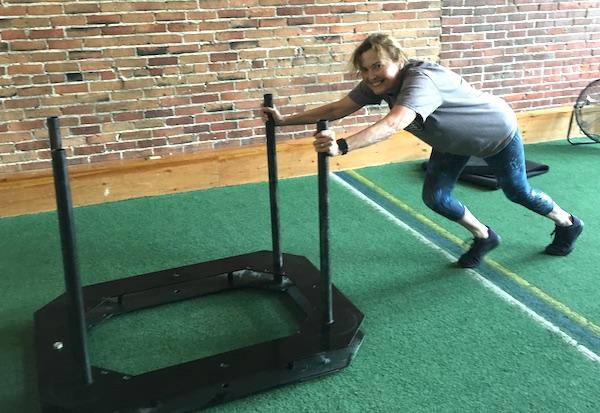 Diane pushing the sled
