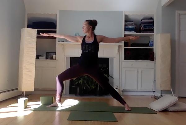 Sarra teaching yoga