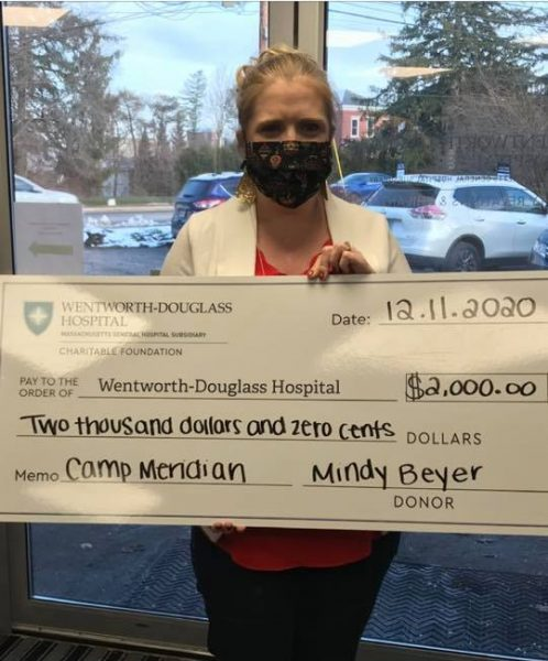 Mindy Beyer with check