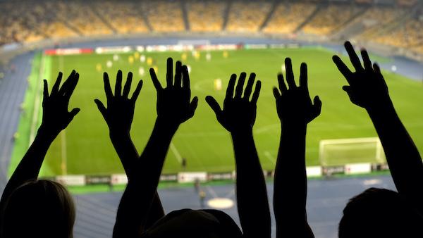 Hands waving, sports event